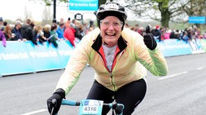 Woman smiling as she competes in Tour de Yorkshire